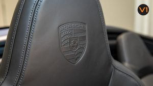 Porsche 911 Carrera Cabriolet - Porsche logo in Headrest